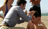Booty buffer Paulo Costanzo gets first aid at the beach