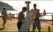 Gay Couple Luke & David Surfing at the Beach