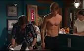 Luke Mitchell has no shirt on