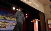 Young lad in on stage striptease at school